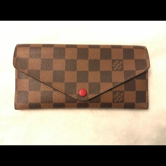 b72380728253 Authentic Louis Vuitton Red Button Wallet. M 5a888a3985e605bb90212bd5